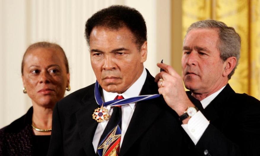 Bush awarding Ali with the Presidential Medal of Freedom in Washington.