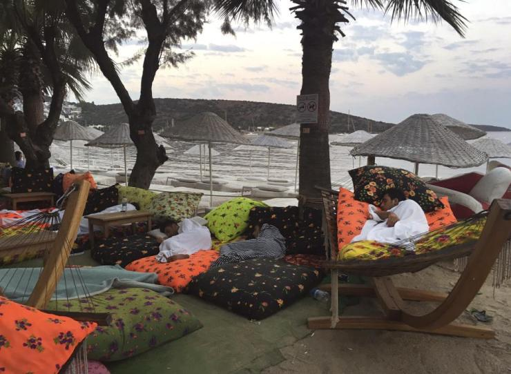 Men asleep on the beachfront following an earthquake in Bitez, a resort town west of Bodrum.