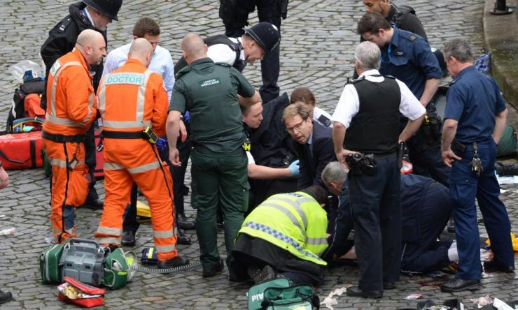 London under attack: Conservative MP Tobias Ellwood (centre) helps emergency services. Which other terror atrocity was he affected by (Q31)?