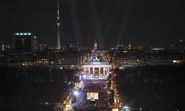 People gather in front of Berlin's landmark Brandenburg Gate.