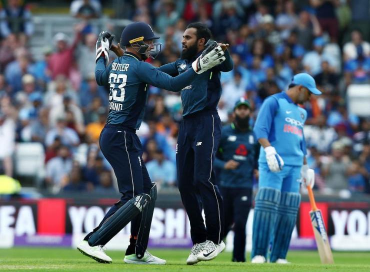 Adil Rashid of England celebrates taking the wicket of Suresh Raina of India