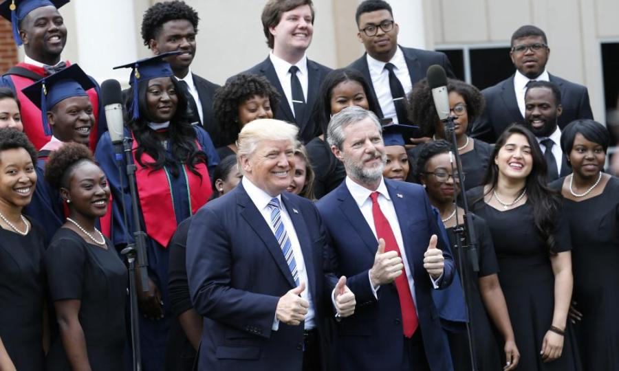 Donald Trump with Liberty University graduates and school president Jerry Falwell on Saturday.
