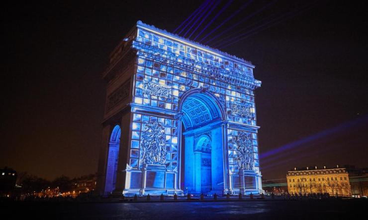 The Arc de Triomphe is illuminated as Paris welcomes in the New Year.