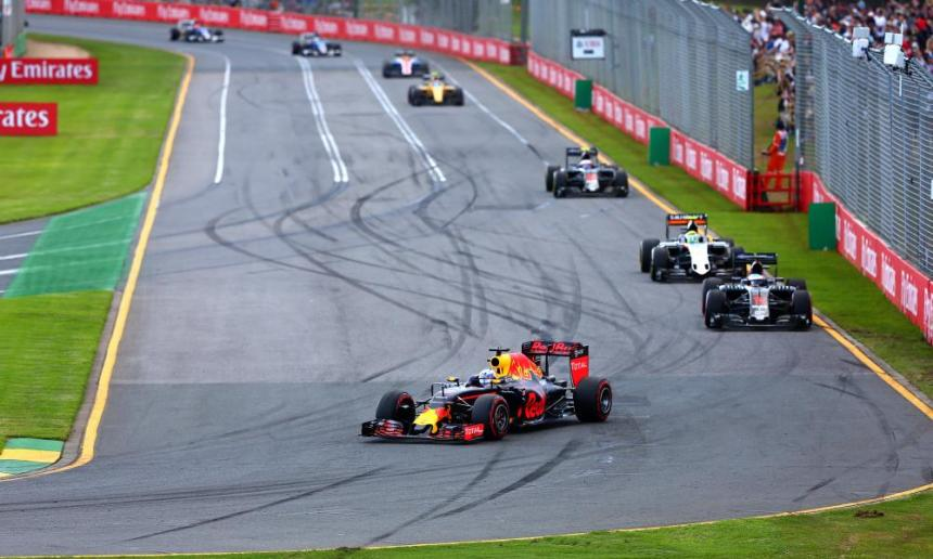 Daniel Ricciardo of Australia and Red Bull Racing turns ahead of Fernando Alonso of Spain and McLaren Honda and Sergio Perez of Mexico.