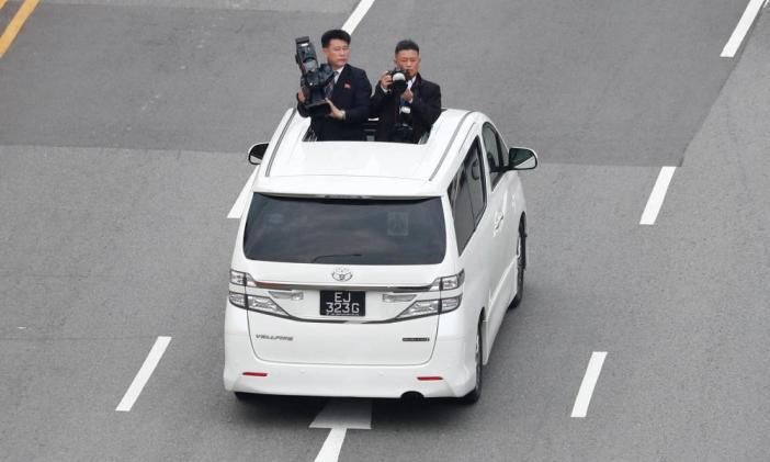 North Korean media travel with the motorcade of North Korean leader Kim Jong Un towards Sentosa for his meeting with U.S. President Donald Trump