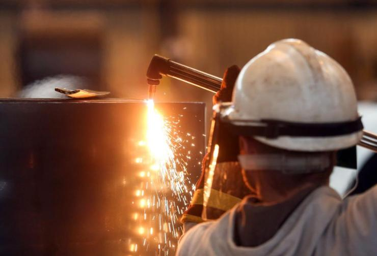An employee at Liberty House Group's rolling steel mill in Newport.
