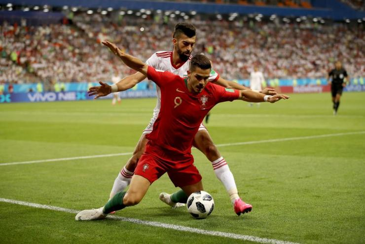 Ramin Rezaeian of Iran challenges Andre Silva.