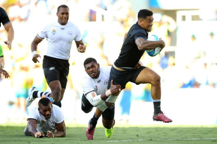Regan Ware (9) scores a try in the Men's Gold Medal Rugby Sevens Match between Fiji and New Zealand on day 11 of the Gold Coast 2018 Commonwealth Games.