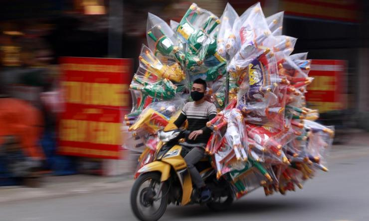 A man rides motorbike loaded with joss paper products for sale in preparation for the Lunar New Year, or Tet holiday in Dao Tu village, in Bac Ninh, Vietnam, 30 December 2019. Vietnamese people often burn joss paper, a papier-mache form of material items such as money, gold, houses, cars during Tet holiday to pray for their ancestors. EPA/LUONG THAI LINH