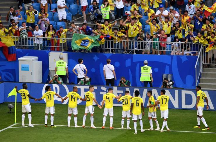 Colombia celebrate in unison.