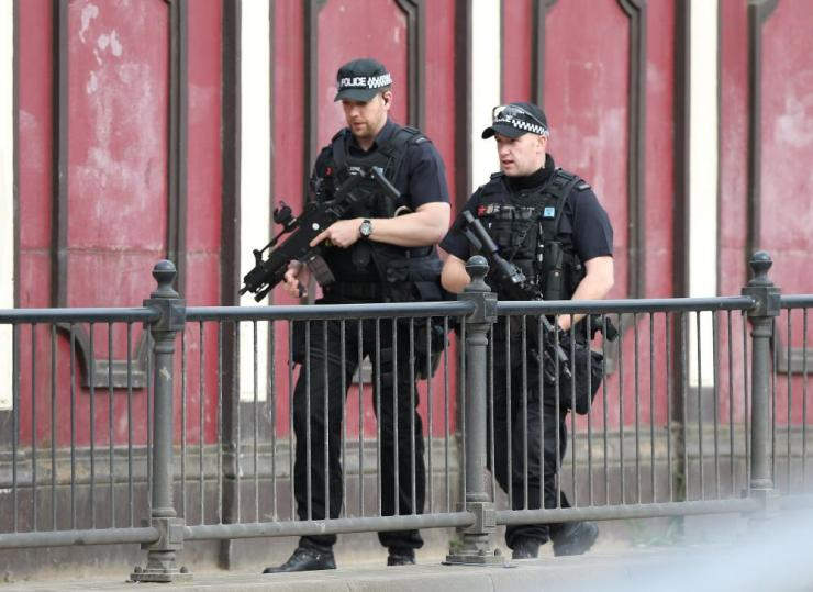 Armed police patrol the Manchester Arena in Manchester