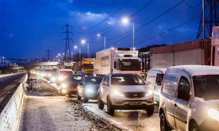 Traffic queueing to leave the M62 motorway ahead of junction 24 after the road was closed between junctions 21 and 24 as extreme weather continued to wreak havoc.