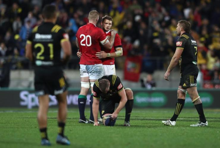 A dejected Dan Biggar of the Lions is consoled by teammate George Kruis, no 20, after missing with a last gasp drop goal attempt to win the match.