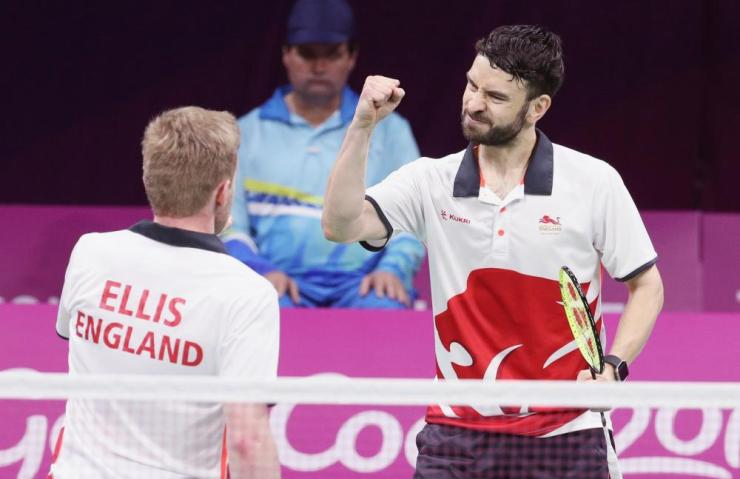 Marcus Ellis and Chris Langridge of England celebrate gold in the men's doubles at the Commonwealth Games.