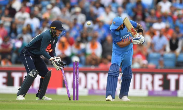 Virat Kohli looks at his stumps