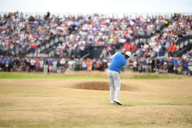 Woods plays off the fairway on the 3rd.