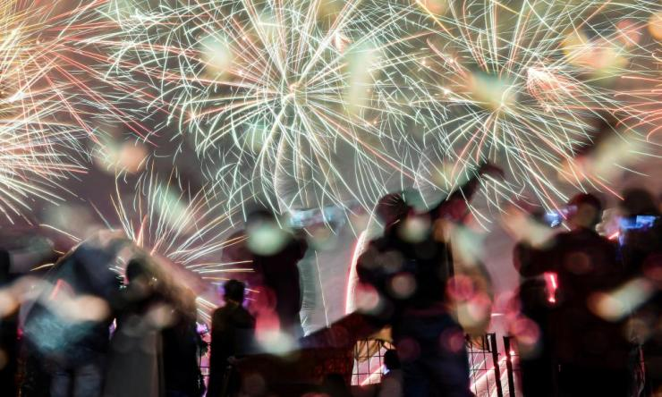 Fireworks explode over Lagoon Beach at Ancol in Jakarta.