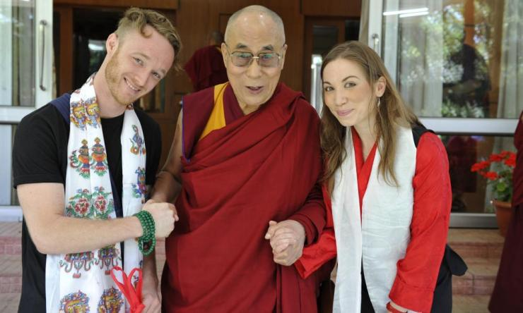 This image released by the Office of His Holiness the Dalai Lama shows the Dalai Lama, centre, ahead of the release of his first album featuring teachings and mantras set to music.