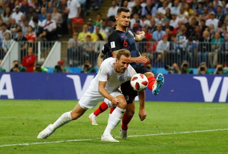 England's Harry Kane is denied by the boot of Croatia's Dejan Lovren.
