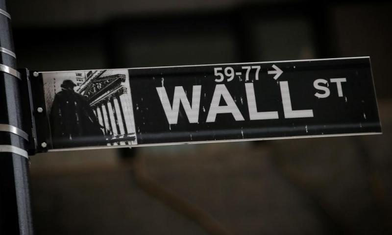 A Wall St. street sign is seen near the New York Stock Exchange.