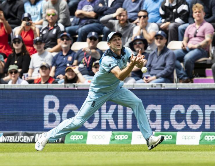 Chris Woakes of England drops a catching chance given by Andre Russell of West Indies.