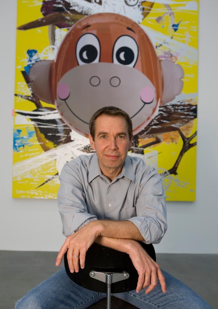 Jeff Koons alongside one of his works of art.