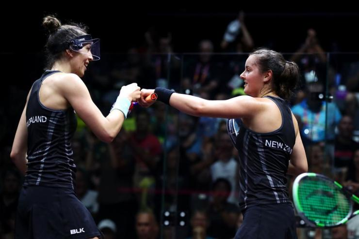 Joelle King (L) and Amanda Landers-Murphy (R) of New Zealand have taken out gold in the women's doubles squash final.