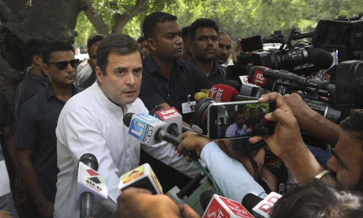 Rahul Gandhi talks to the media after casting his vote.