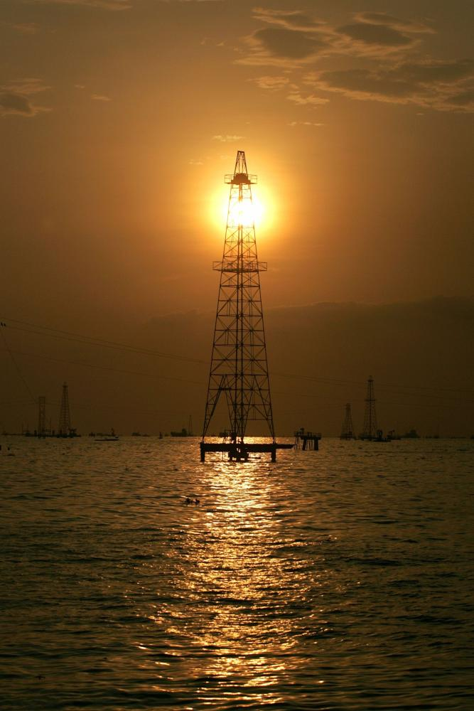 Oil rig is seen during sunset at Lagunillas field in the eastern coast of Lake Maracaibo.