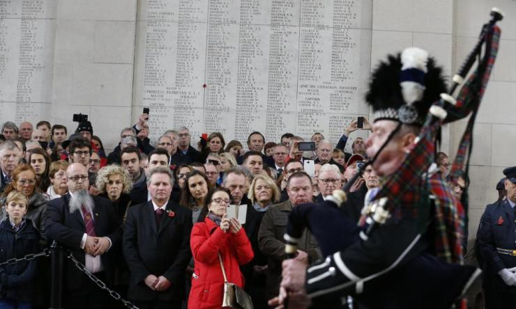 People attend a special edition of the last post ceremony at the Commonwealth War Graves Commission Ypres Memorial at the Menenpoort at Menin Gate, Ypres.