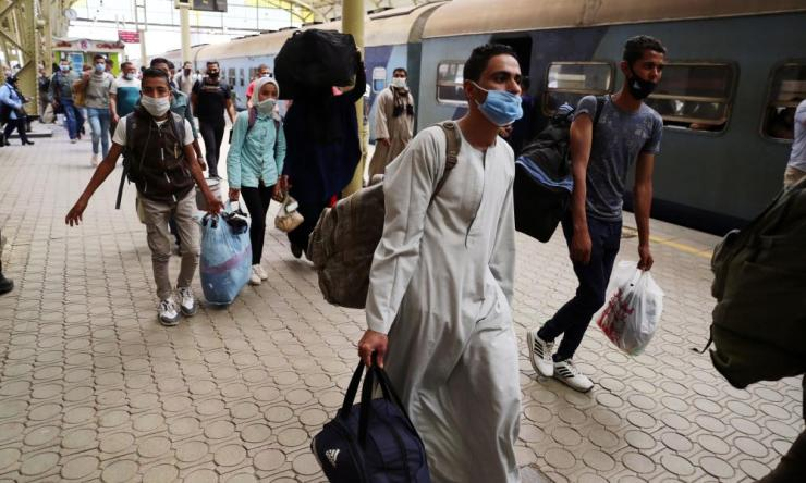 People wearing face masks are seen at Ramses railway station in Cairo.