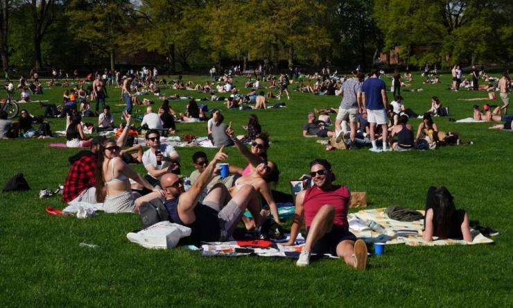 People enjoy Sheep Meadow in Central Park during the coronavirus pandemic on May 2, 2020 in New York City.