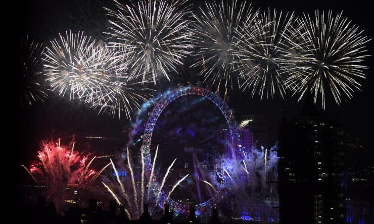 Fireworks explode over London Eye, Westminster Abbey and Elizabeth Tower near Parliament as thousands of revellers gather along the banks of the River Thames.