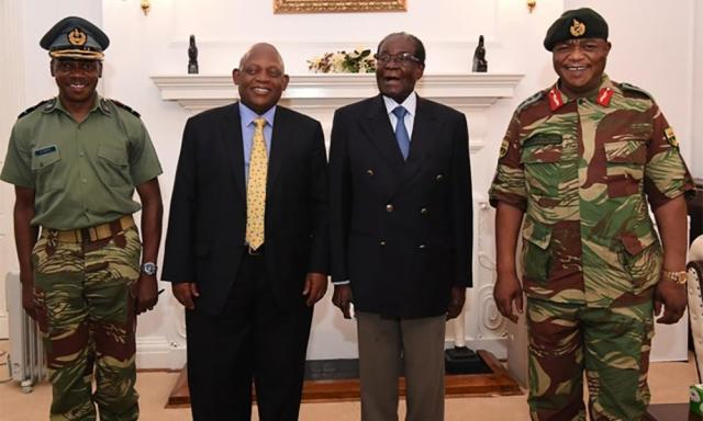 Mugabe (second right) with Gen Constantino Chiwenga (right) and South African envoys