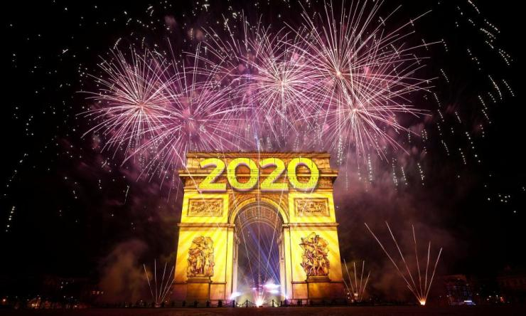 Fireworks illuminate the sky above the Arc de Triomphe.