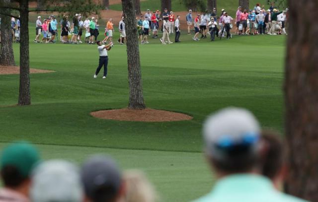 Molinari hooks around the trees on 7th.
