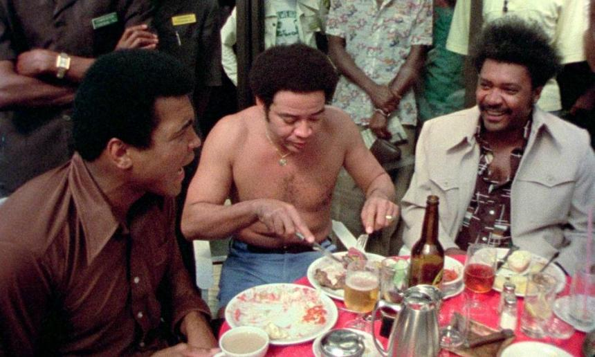 Muhammad Ali dines with Bill Withers and Don King