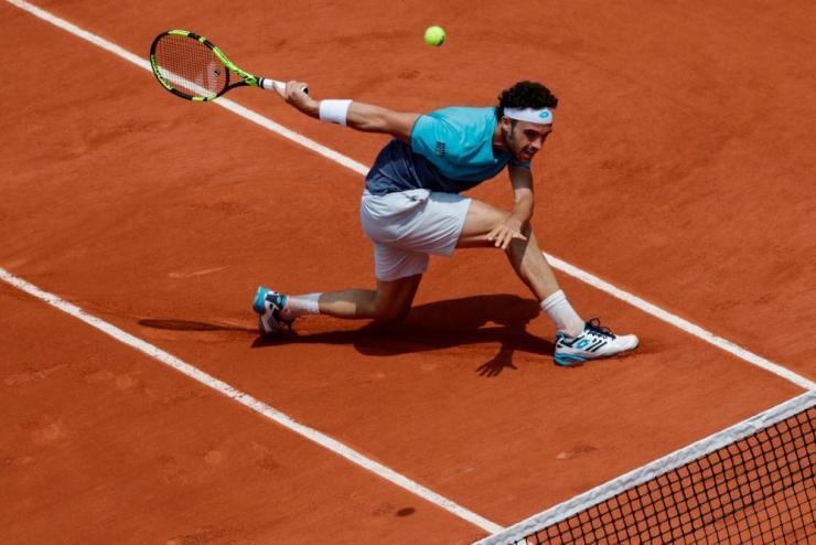 Marco Cecchinato returns the ball to Dominic Thiem.