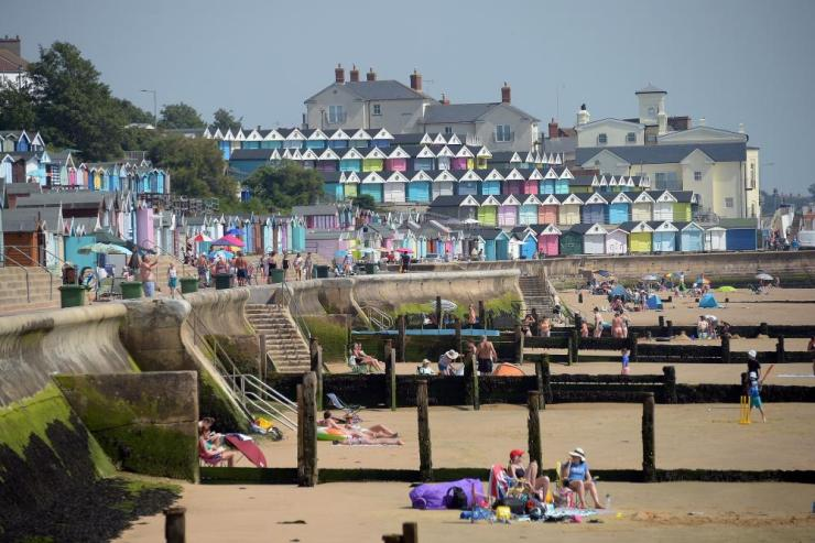 People sunbathing in Walton on the Naze, Essex.