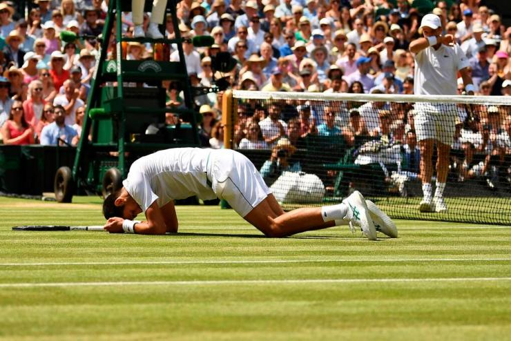 Novak Djokovic slips over.