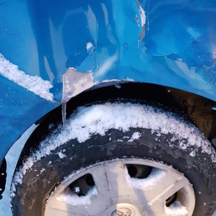 Blue car with cracks and ice in it