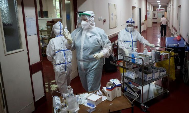 "Medical workers bring medications to patients suffering from coronavirus disease (COVID-19) inside the Institute for Orthopaedic Surgery ""Banjica"", recently transformed to a Covid hospital, in Belgrade, Serbia. The small Balkan country is experiencing a resurgence of the pandemic."