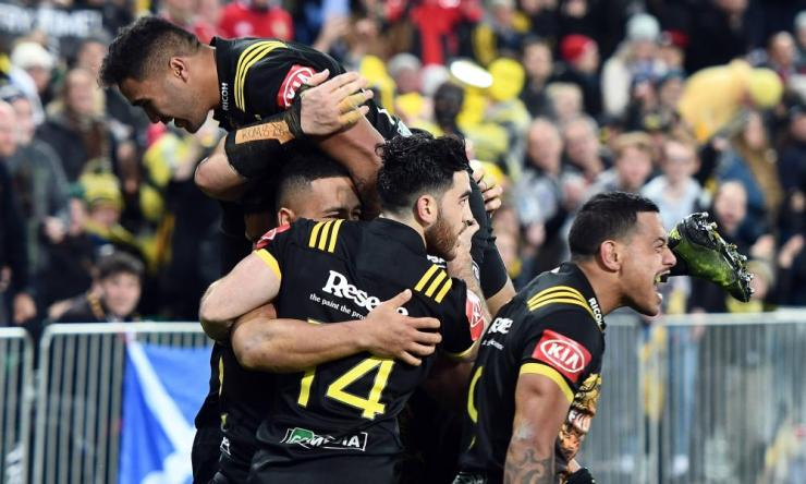Hurricanes celebrate Ngani Laumape's try.