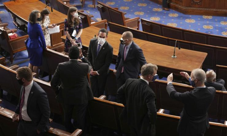 Members of Congress await Joe Biden's address to a joint session.