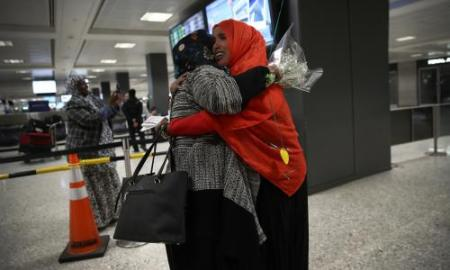 Donald Trump s first 100 days as president     daily updates   US news     A woman hugs her daughter arriving from Somalia at Dulles international  airport on 6 February  Photograph  Win McNamee Getty Images