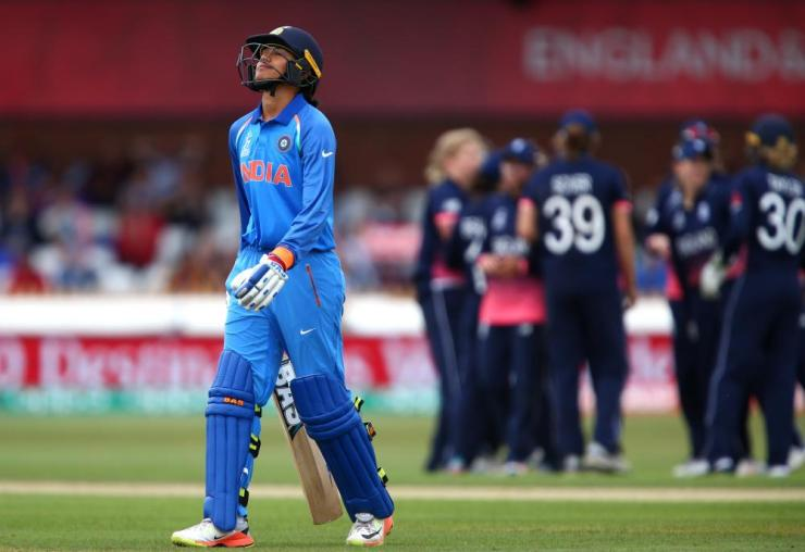 Smriti Mandhana of India leaves the field after getting out for 90.