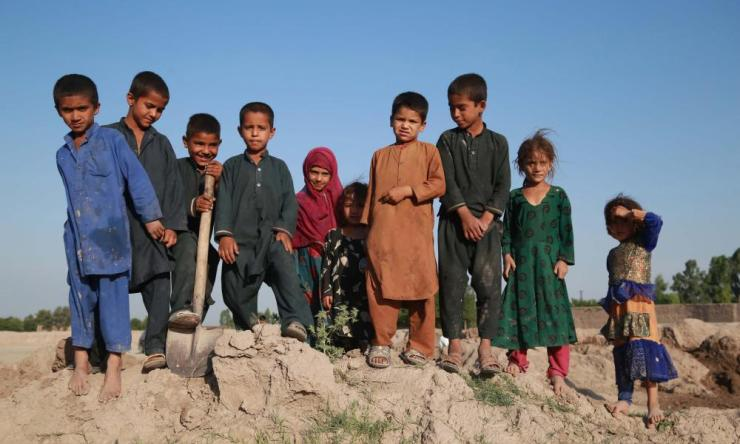 Afghan children pose for a photograph as they help their family at a brick kiln in Jalalabad, Afghanistan.