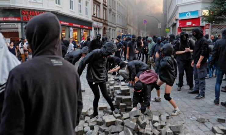 Rioters collect stones in Schanzenviertel quarter in the St. Pauli district during the G-20 summit in Hamburg, Germany.