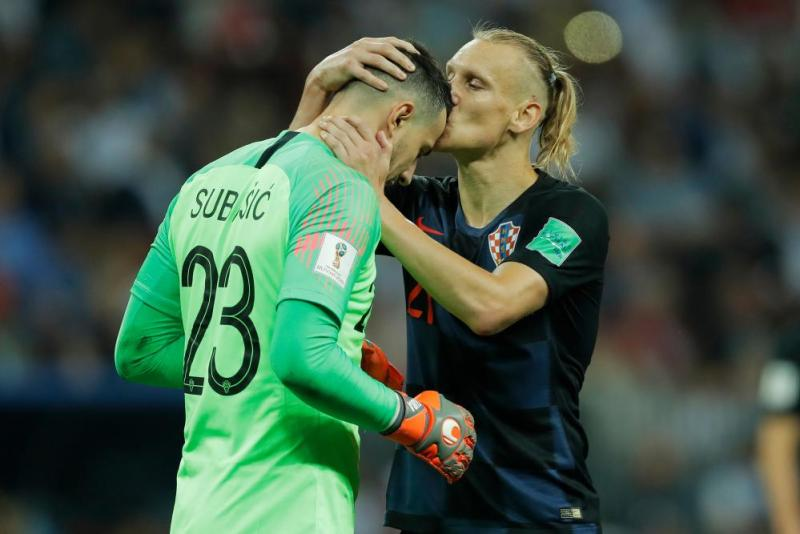 Down the other end of the pitch Vida celebrates with Subasic.