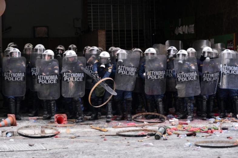 """Farmers throw objects at police blocking the entrance to the Agriculture ministry in Athens, during a demonstration against the pension reform on February 12, 2016 Fears that Greece will exit the eurozone, a """"Grexit"""", could revive if Greek authorities do not come up with """"credible"""" reforms, notably on pensions, a senior IMF official said February 11, 2016. / AFP / LOUISA GOULIAMAKILOUISA GOULIAMAKI/AFP/Getty Images"""